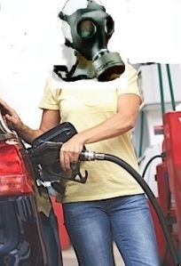 woman in mask pumping gas